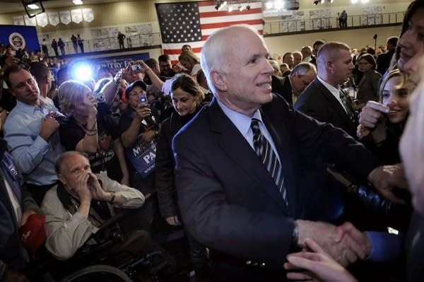 McCain shakes hands with supporters