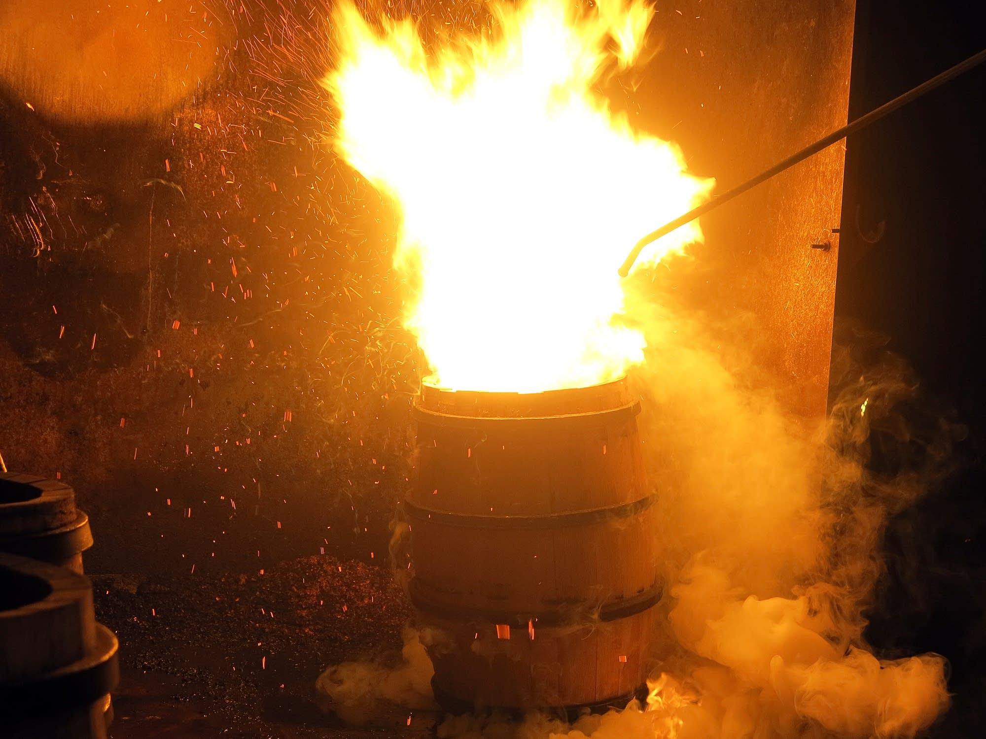 Dan Lehmkuhlertoasts the inside of each barrel.