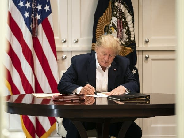President Donald Trump works in the Presidential Suite at Walter Reed