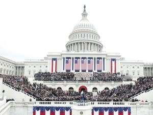 Guests sit on the West Front of the Capitol.