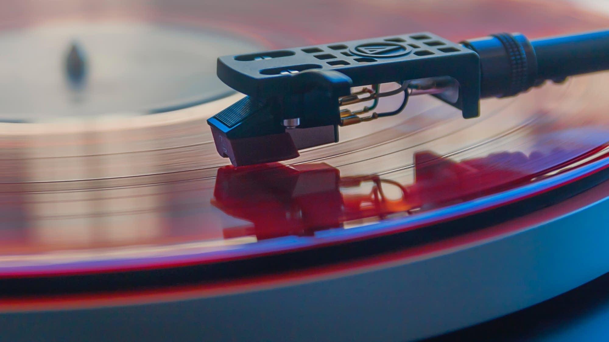 A vinyl record plays