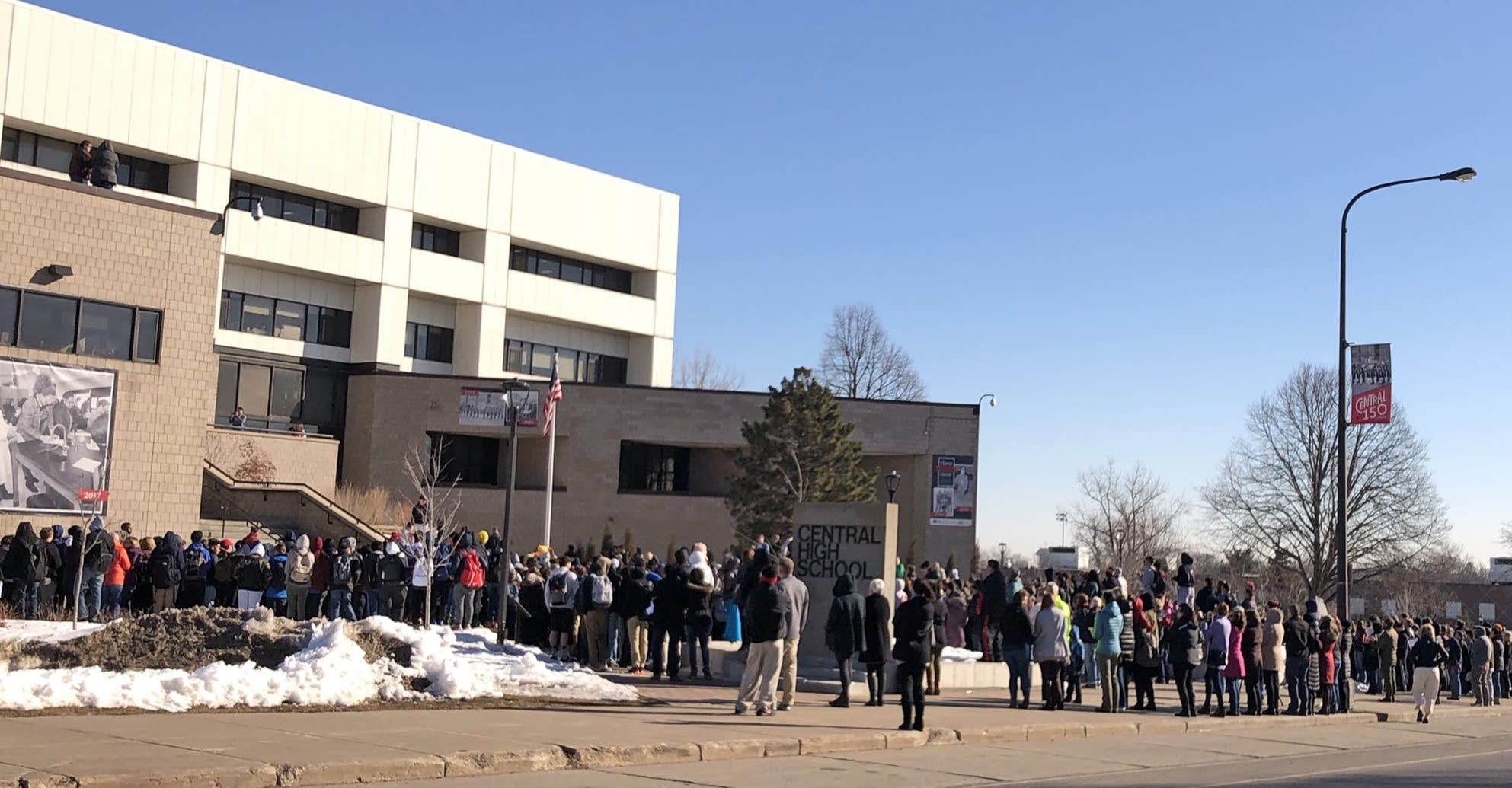 Students gather outside St. Paul's Central High School.