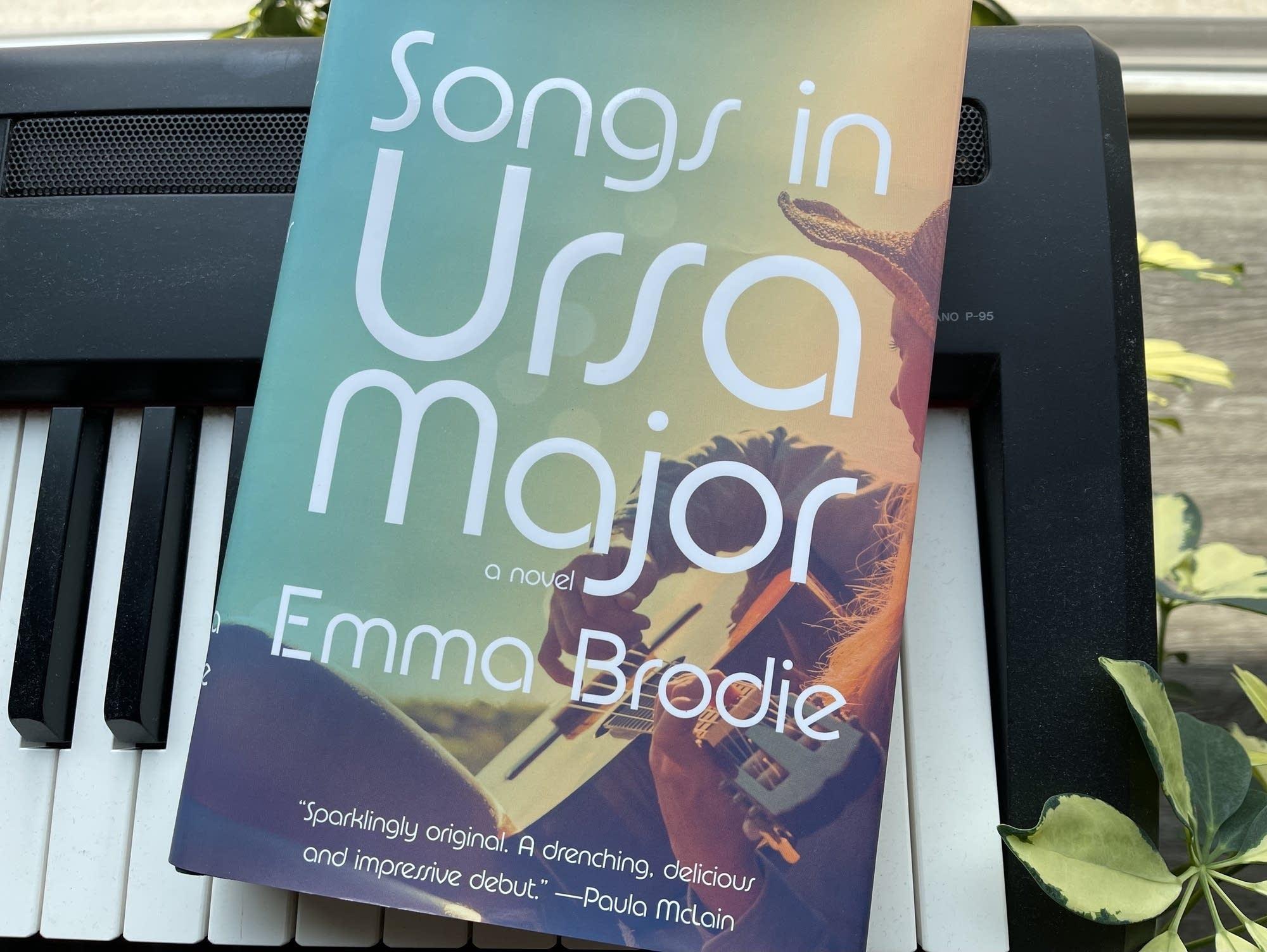 Book on keyboard: 'Songs in Ursa Major.'