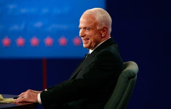 John McCain smiles during the debate