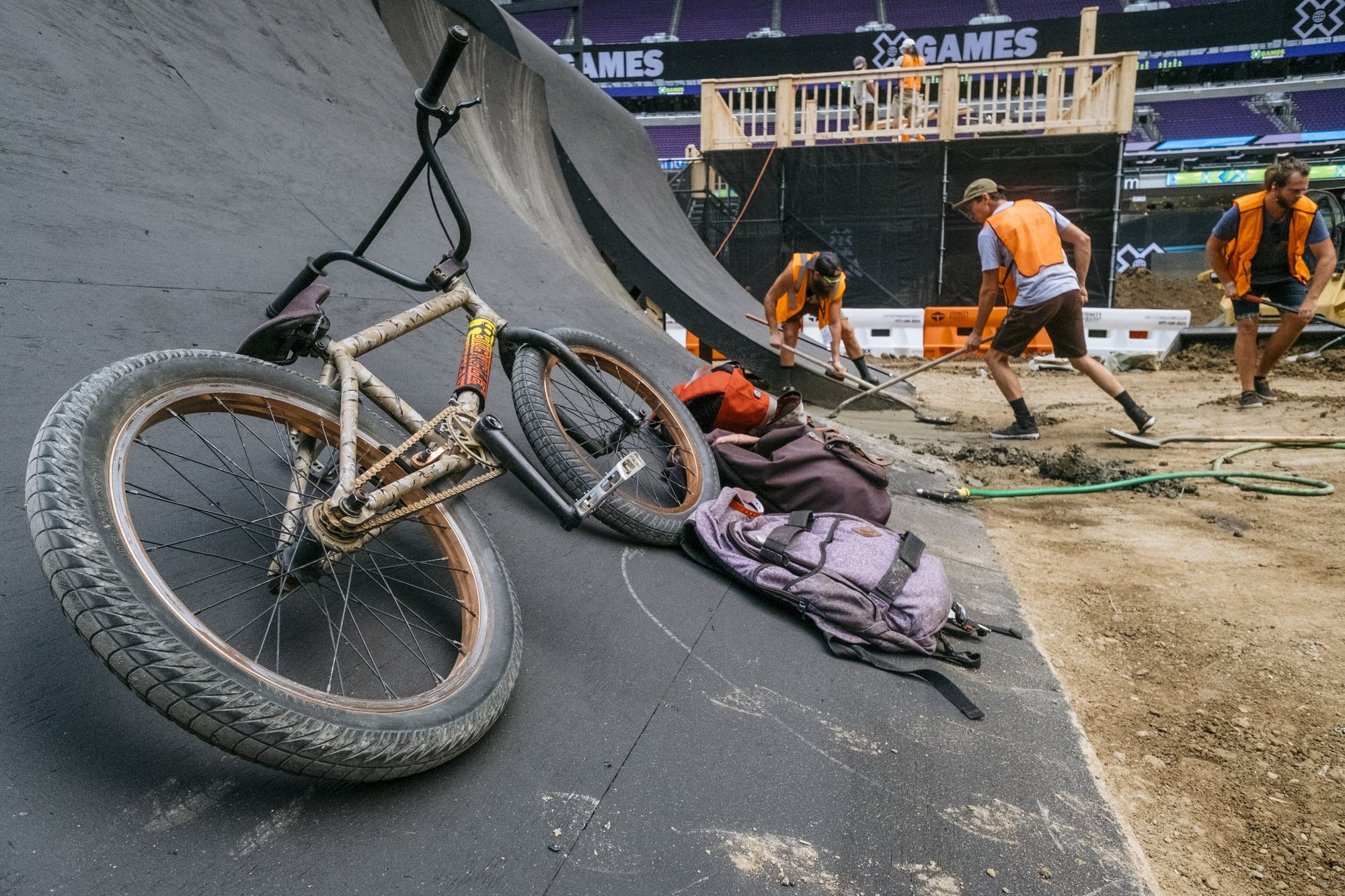 A BMX bike leans on a quarter pipe.