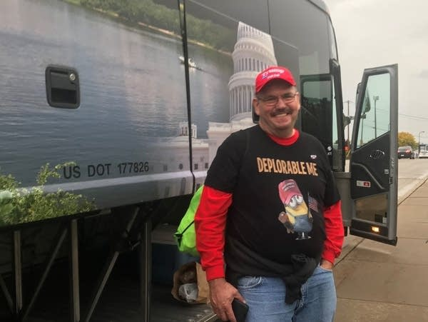 Andy Carlson of Darwin, Minn., stands outside of the charter bus