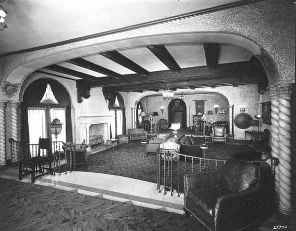 A black and white picture of a hotel lobby.
