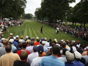 Tiger Woods tees off at Hazeltine in Chaska, Minn.