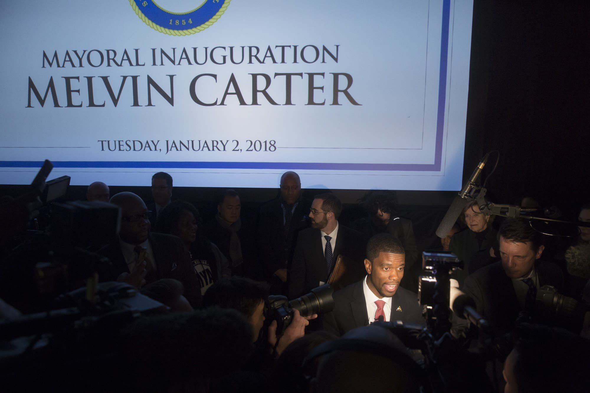 St. Paul Mayor Melvin Carter speaks with reporters