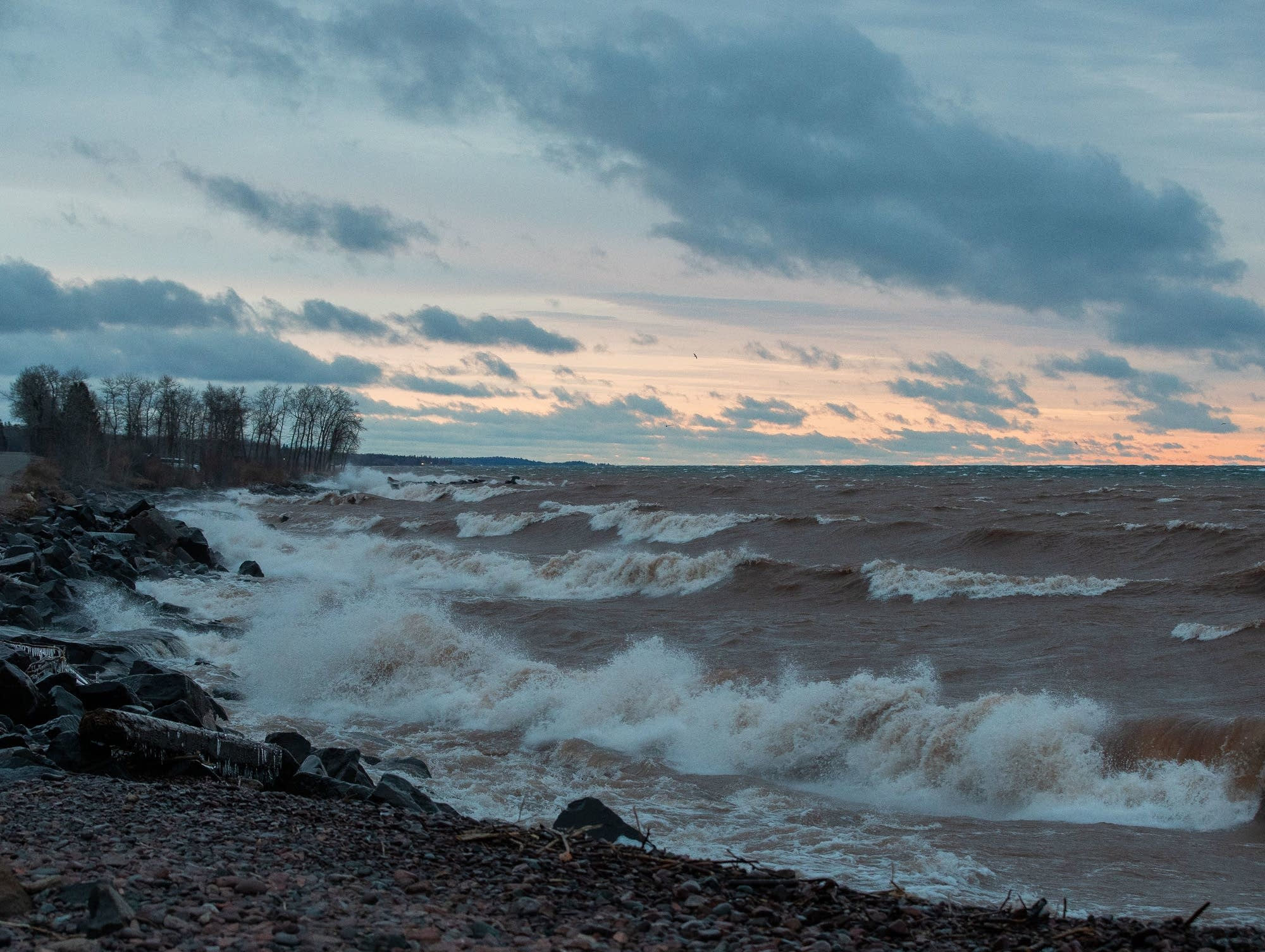 Waves begin to come ashore at Brighton Beach in Duluth on April 11, 2019.