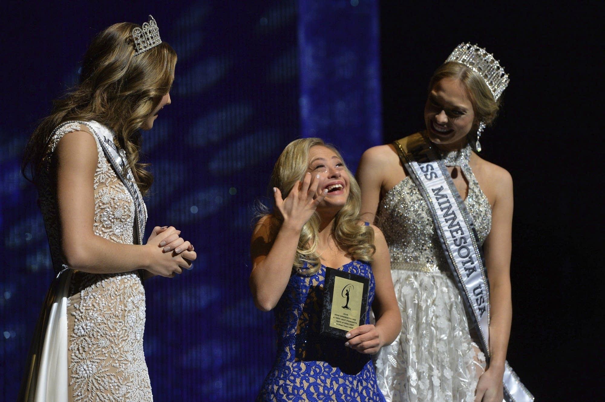 Mikayla Holmgren, center, accepts the Spirit Award.