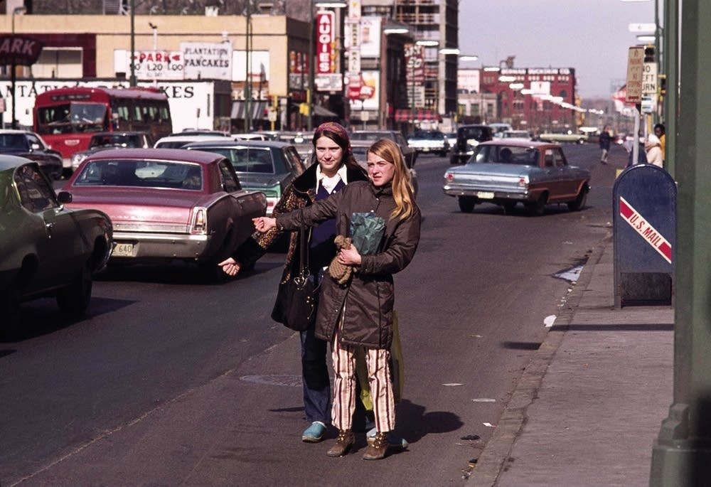Young girls hitchhiking on Hennepin.