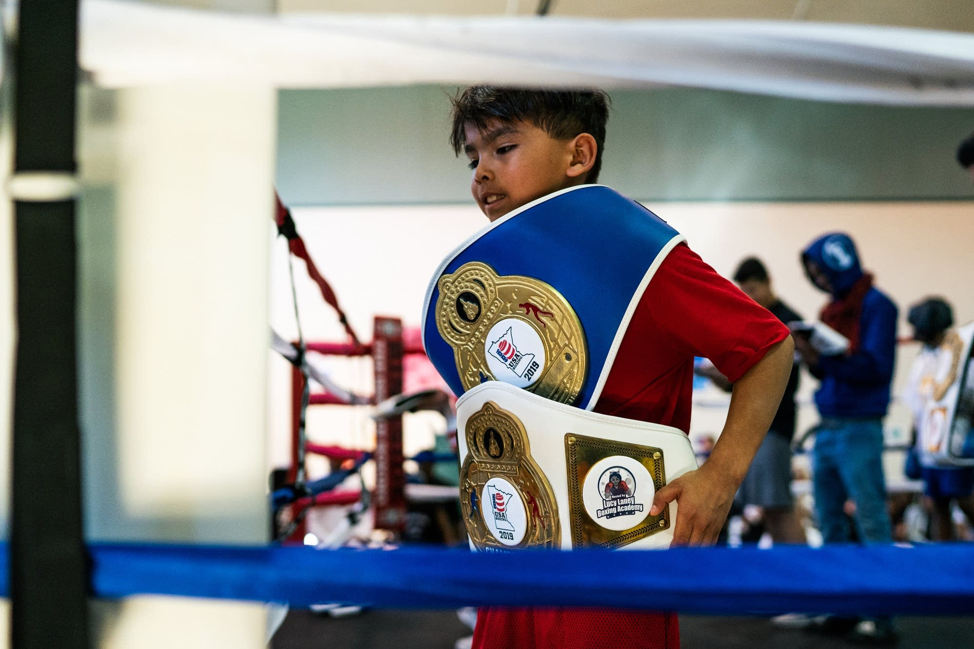 Eight-year-old Gabriel Luna poses for a picture inside the ring