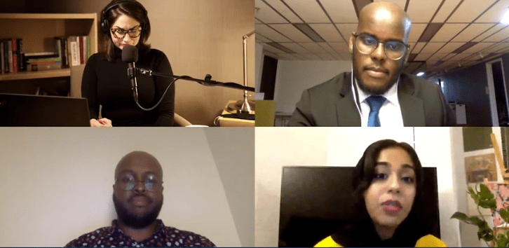 Four people talk on an online call.