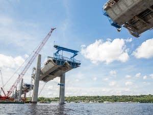 Bridge segments are moved into place.