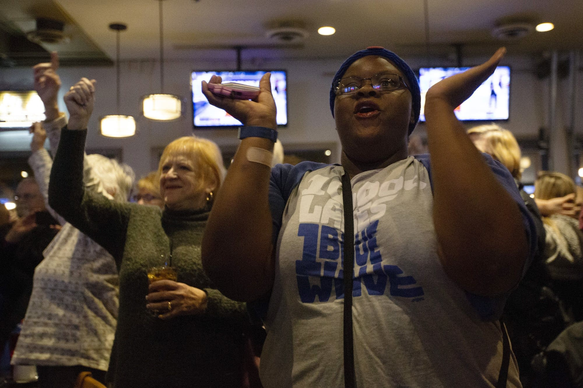 Sasha Williams celebrates as Democrats take control of the Minnesota House.
