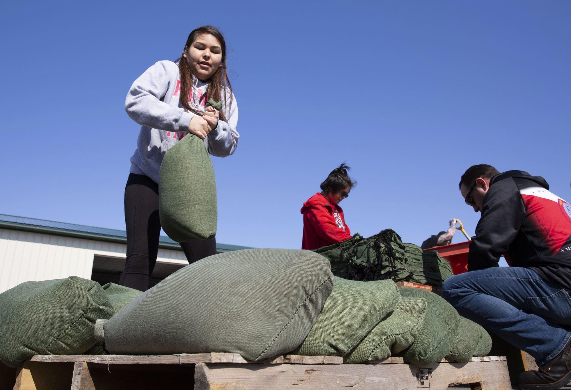 Laraina Franks, 15, helps fill sandbags.