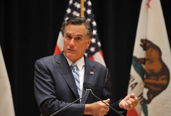 Romney speaks with reporters