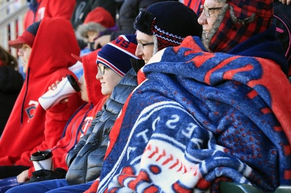 Fans huddled under blankets to keep warm.