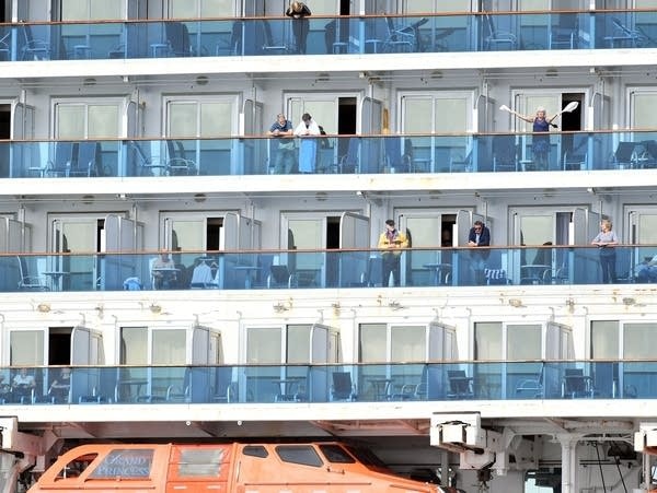 People look out from aboard the Grand Princess cruise ship