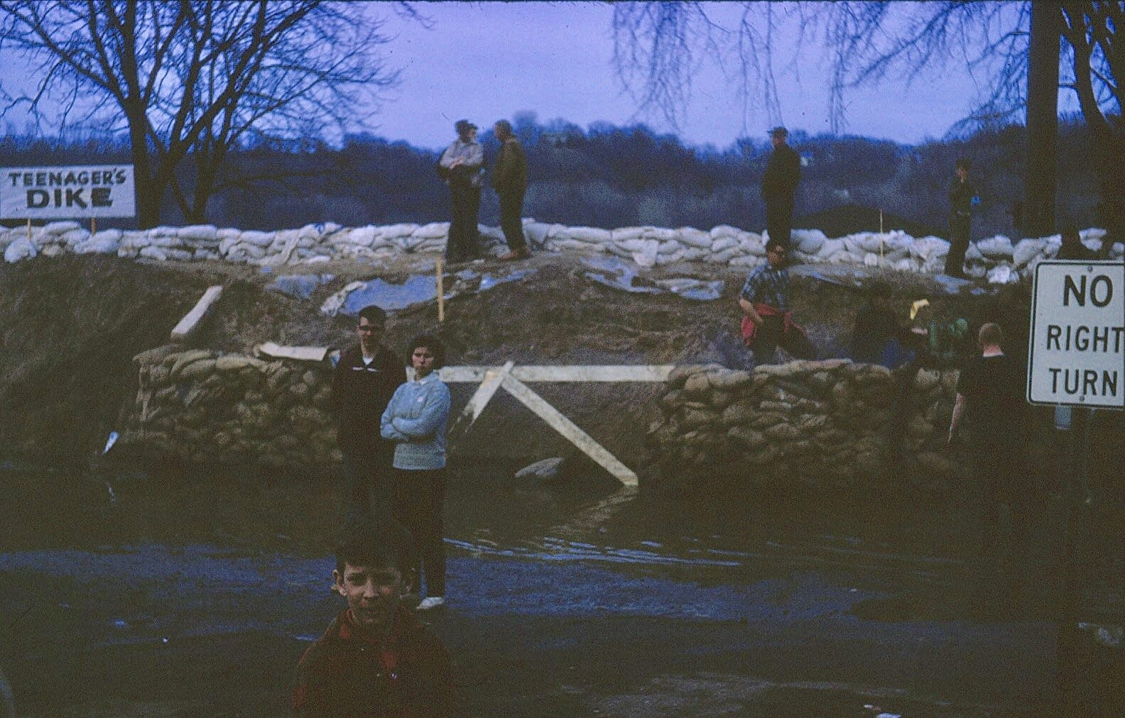 People stand on Teenager's Dike.