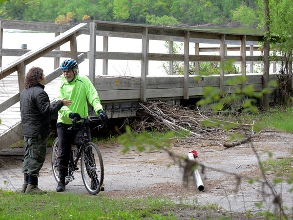 Fort Snelling State Park manager Kelli Bruns talks to a bicyclist