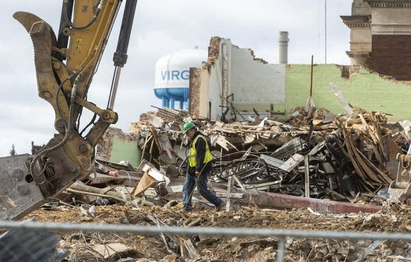 A demolition crew member inspects an area of the Northland Building.