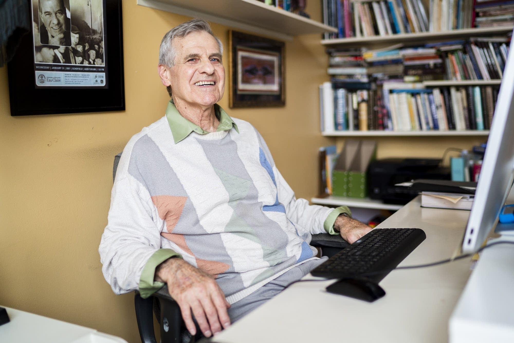 Author Michael Fedo sits for a portrait inside his Coon Rapids, Minn. home.