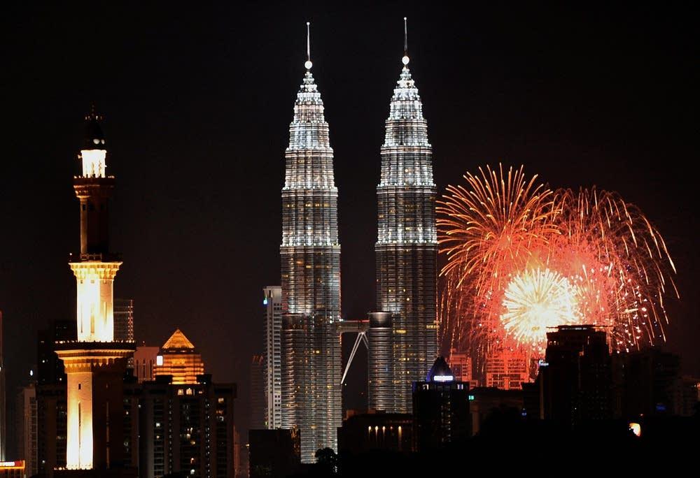 Fireworks light up the sky near the Malaysia