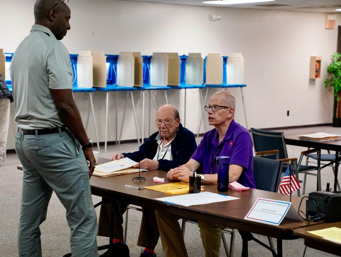 Judges Roger Guarino, right, and Richard Hall greet Demetrius Brooks.