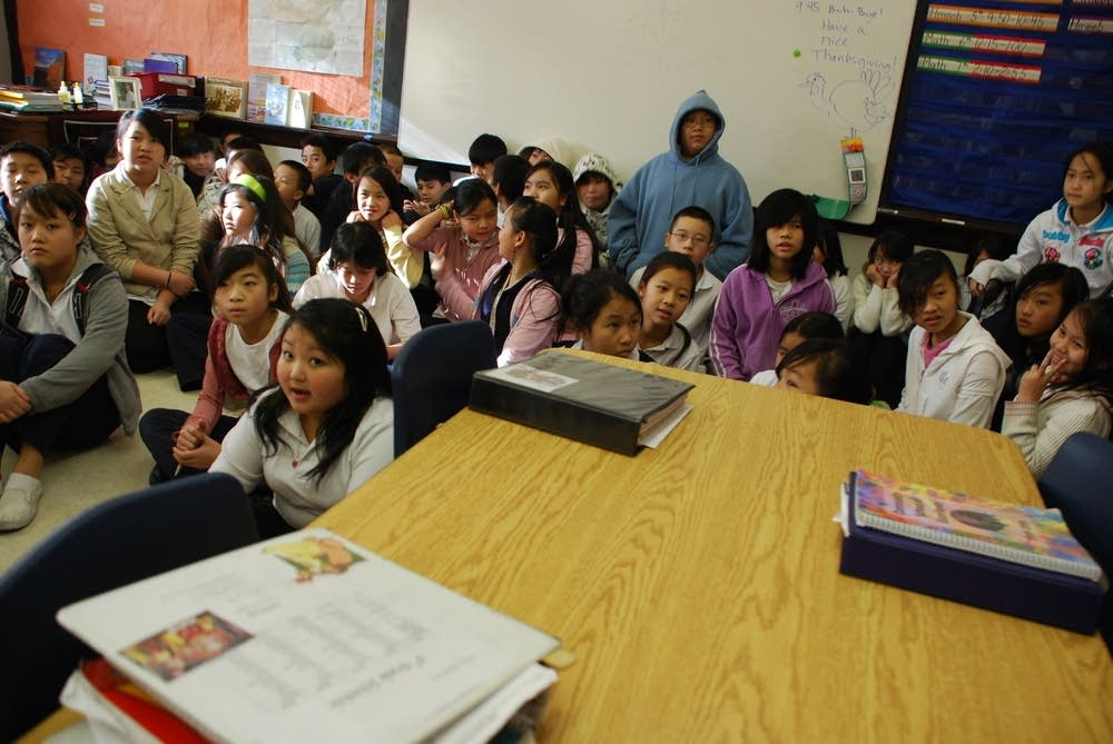 Students practice a song forthe Hmong New Year
