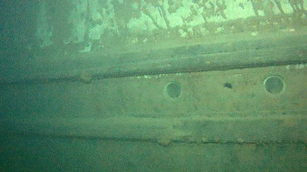 Portholes are seen in the hull of the wrecked freighter Hudson