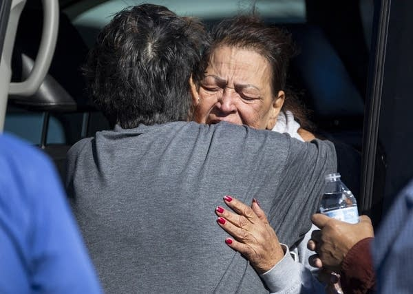 A family member reacts at the scene of a fatal shooting