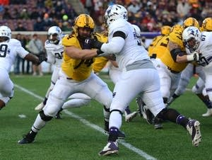 Gopher Nick Connelly, No. 74, in a game against Northwestern University.