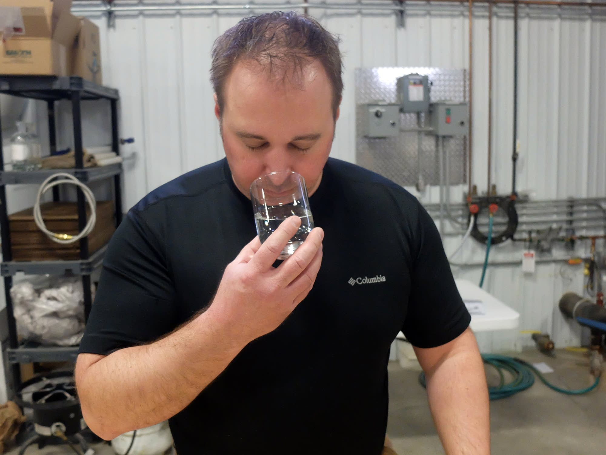 Mike Swanson inhales the scent from raw distillate.
