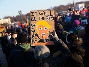 A sign mocks President Trump.