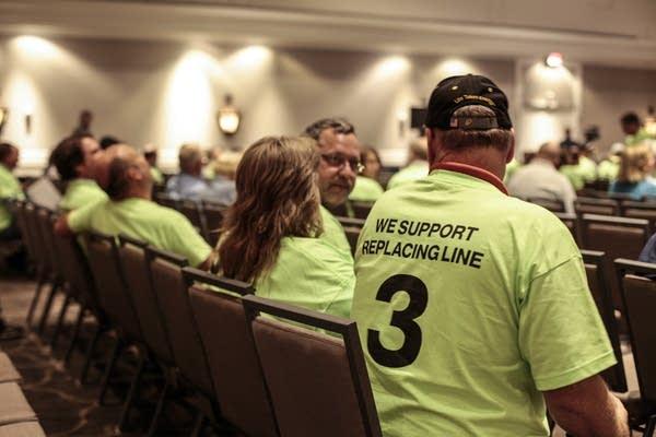 Enbridge Line 3 supporters attend a public hearing in St. Paul last year.