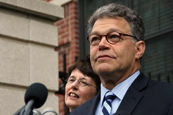 Al Franken addresses media outside his home