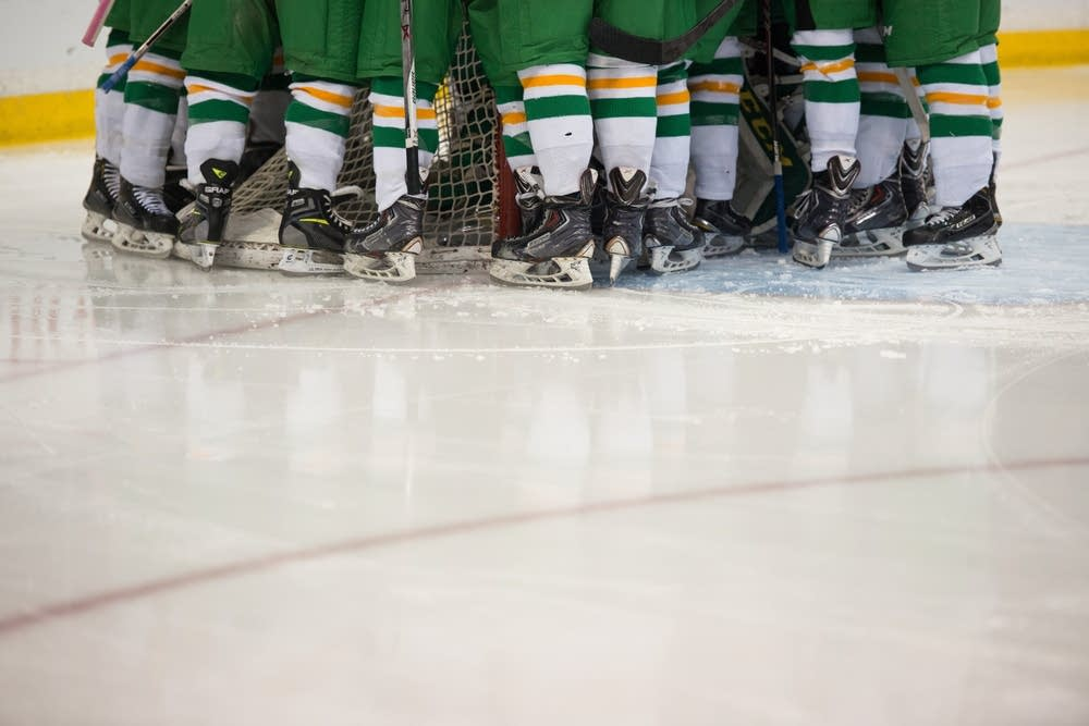 Edina players huddled before the semifinal game.