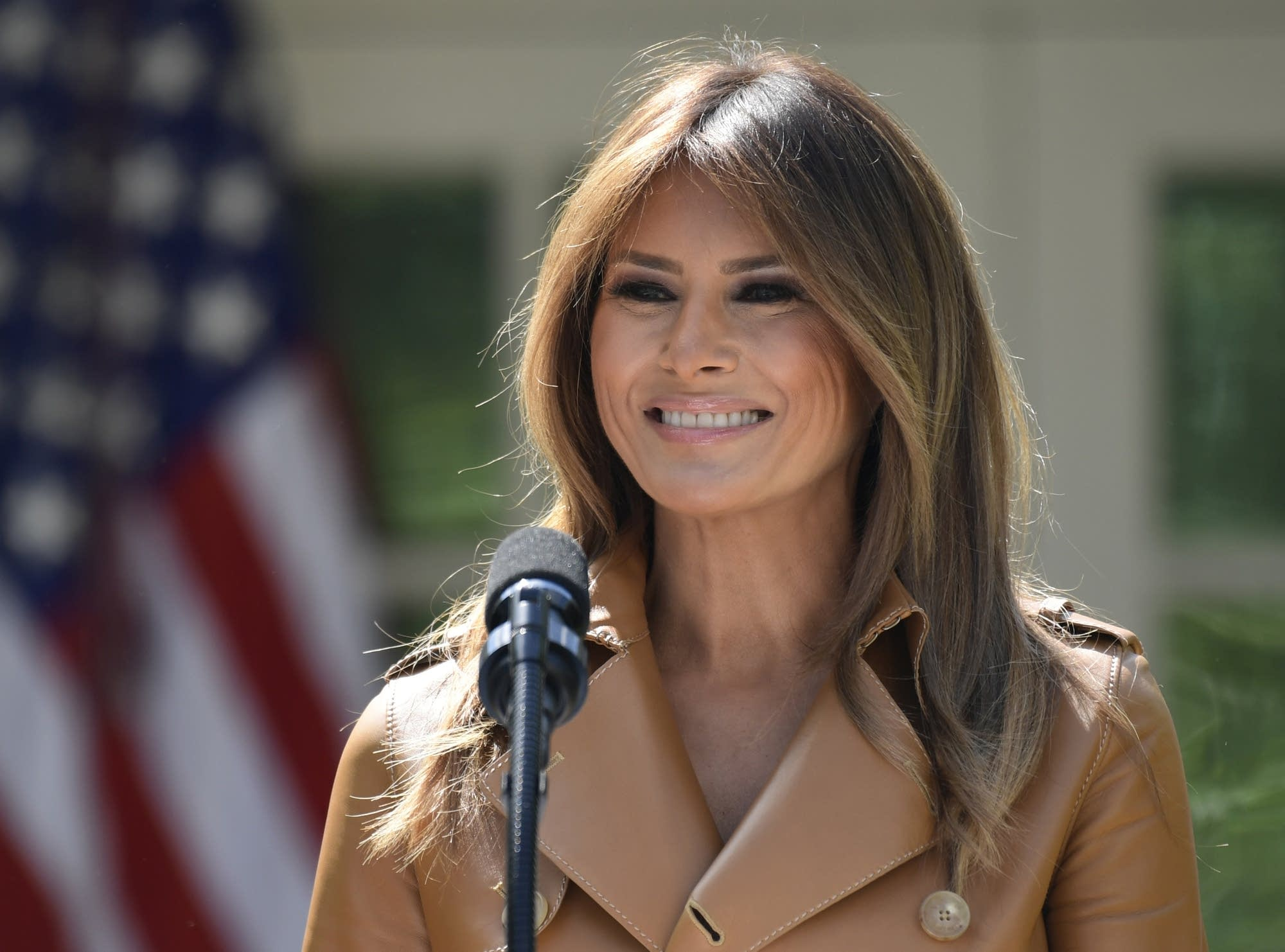 First lady Melania Trump speaks at an event in the Rose Garden.