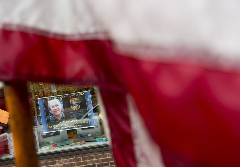 Signs in Aitkin storefronts honored Sandberg.