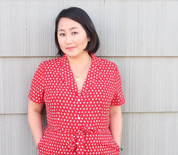 A person wearing a red dress with white polka dots.