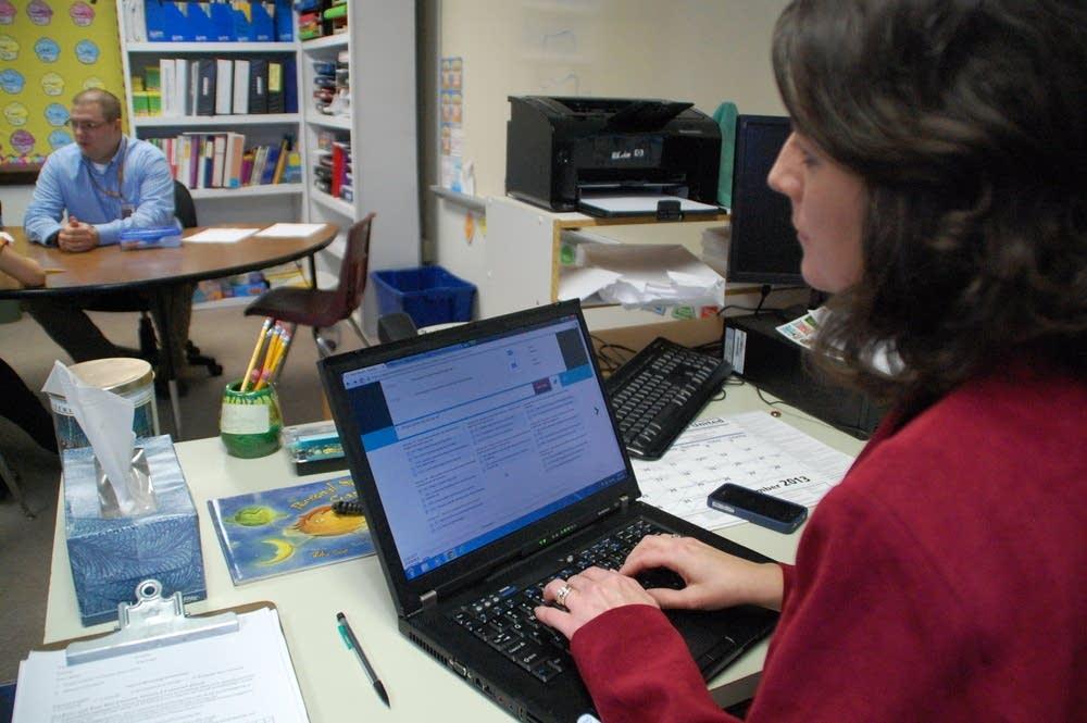 Principal Cindy Hansen takes notes