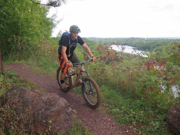 Aaron Hautula bikes to the top of Miner's Mountain