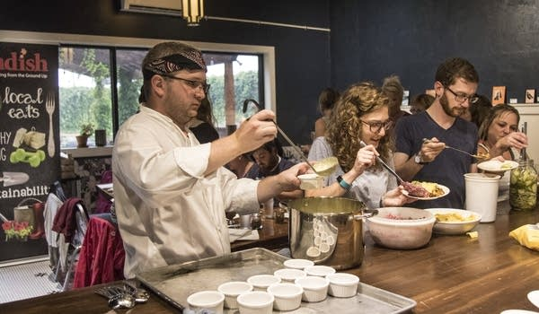 Chef David Bredesen serves up bowls of a hot pickle soup.