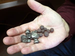 Mark Skelton holds taconite pellets.