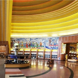 The grandly spacious interior of the Cincinnati Museum Center/Union Depot Rotunda…note the WPA murals that outline the city's history, also the metal grills at floor level on either side of the central walkway (toward the right), behind which are the main organ chambers, and the 'window' above the doorway (on the far left of this photo), which hides the Antiphonal division. Now you understand about the resonance of the space!