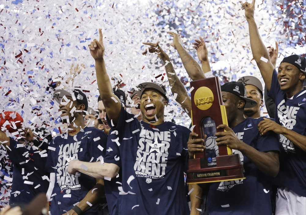 UConn celebrates with the championship trophy