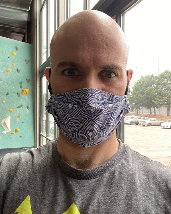 A man wearing a mask in a photograph.