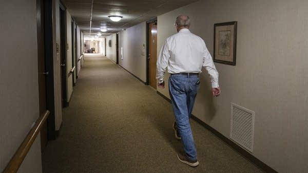 A man walking down a hallway